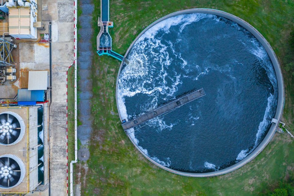 Aerial view of a water treatment tank with waste water.